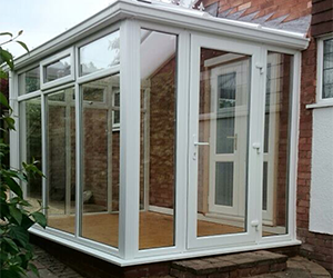 Bricked conservatory with astrical bar windows