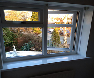 white upvc window with full opener and top opener