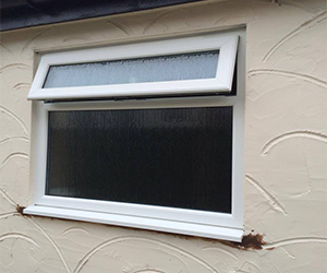 white upvc window with top opener with obscure glass