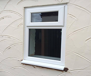 white upvc window with top opener with clear glass