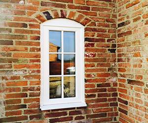 white upvc window with white gastrical bar