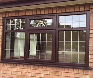 leaded mahogany upvc window with bevalled glass